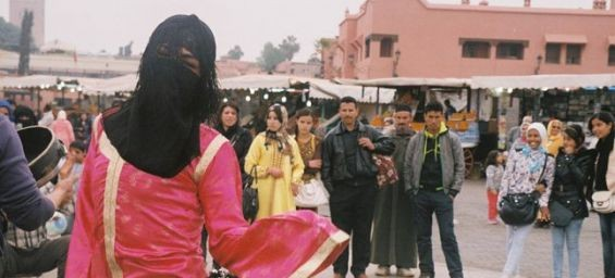 Morocco male dancers in women's clothing... entertain to fit in
