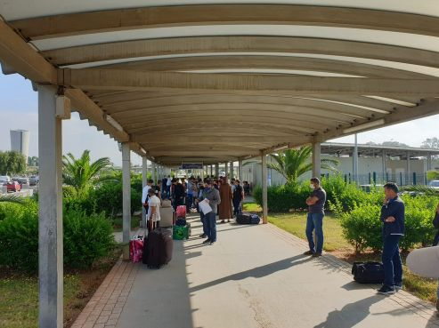 A group of Moroccans awaiting repatriation at the Houari Boumedien airport in Algiers